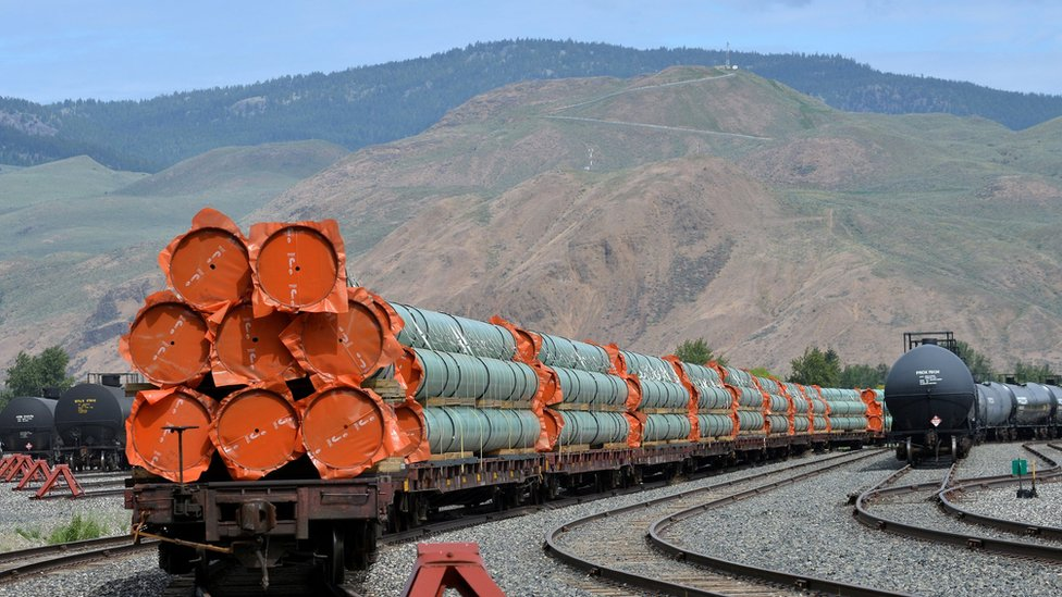 """Steel pipe to be used in the oil pipeline construction of Kinder Morgan Canada""""s Trans Mountain Expansion Project sit on rail cars at a stockpile site in Kamloops, British Columbia,"""
