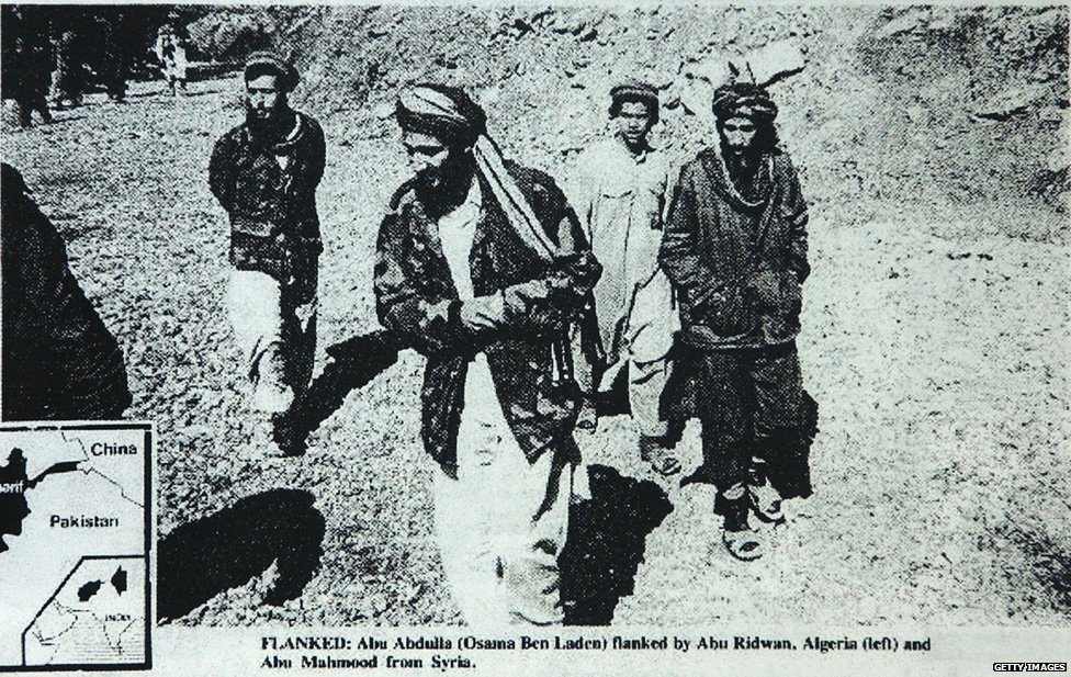 Federal prosecutors in Chicago say that this photo, published May 4, 1988, in the English-language newspaper 'Arab News,' shows Enaam Arnaout (R), head of the Palos Hills, Illinois branch of the Islamic charity Benevolence International Foundation, walking with Osama bin Laden