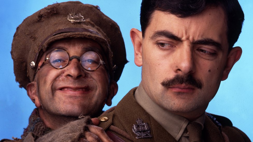 Still from the BBC comedy Blackadder Goes Forth, showing Tony Robinson as Private S Baldrick and Rowan Atkinson as Captain Edmund Blackadder