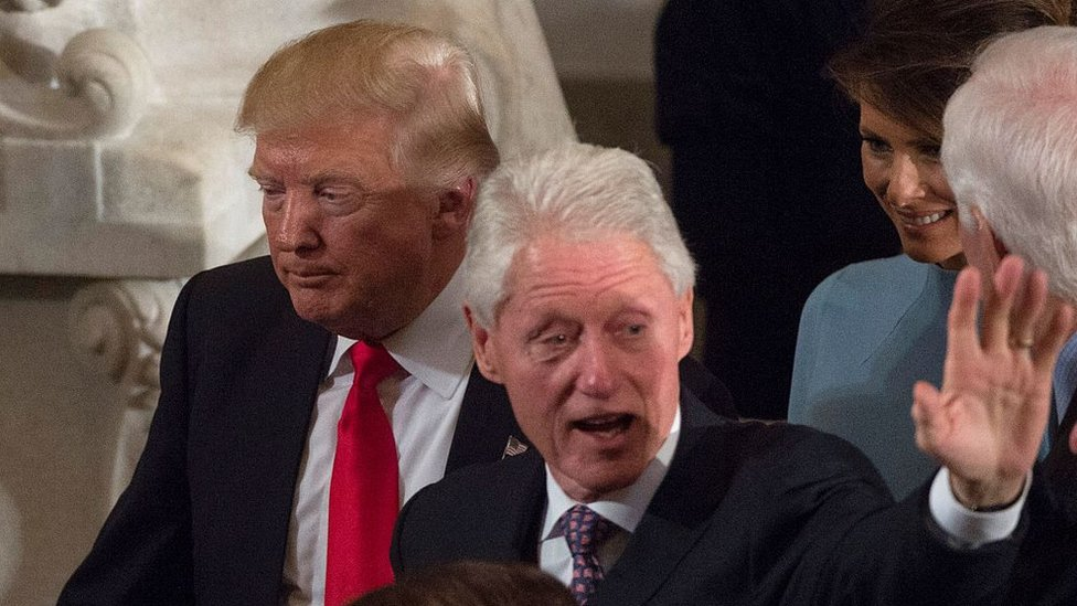 US President Donald Trump passes former President Bill Clinton at the Trump inauguration in Washington, January 2017