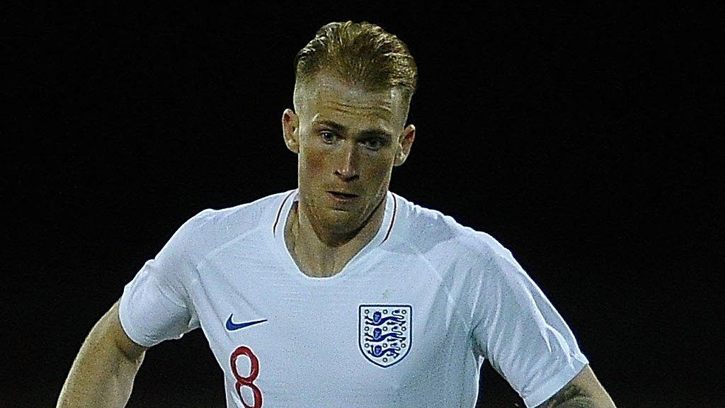 Mitch Pinnock: Midfielder joins AFC Wimbledon from Dover