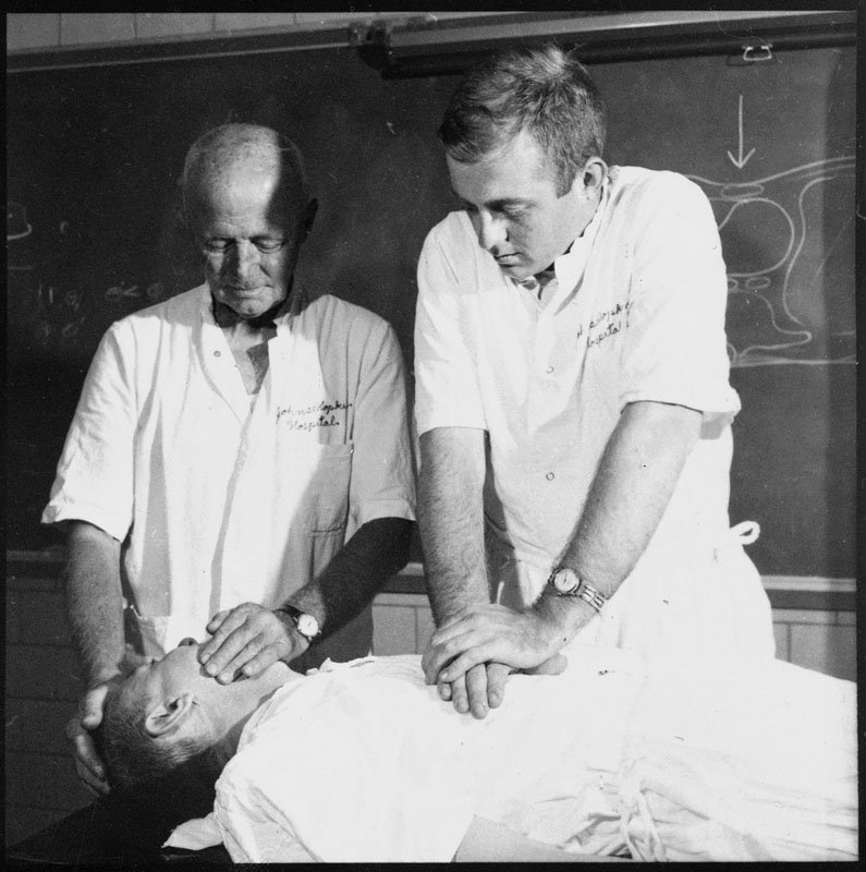 Guy Knickerbocker, right, performs CPR