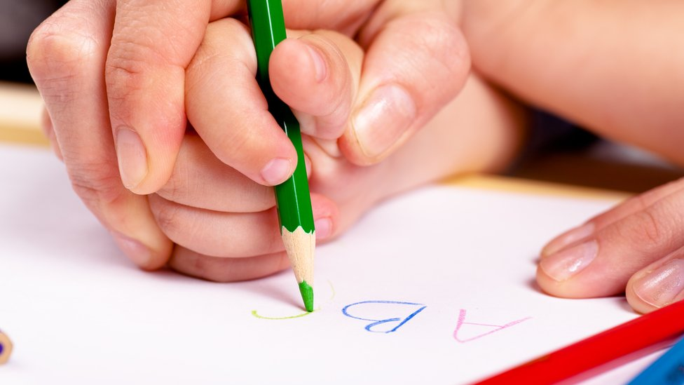 Teach Reception children how to grip a pencil, says Ofsted