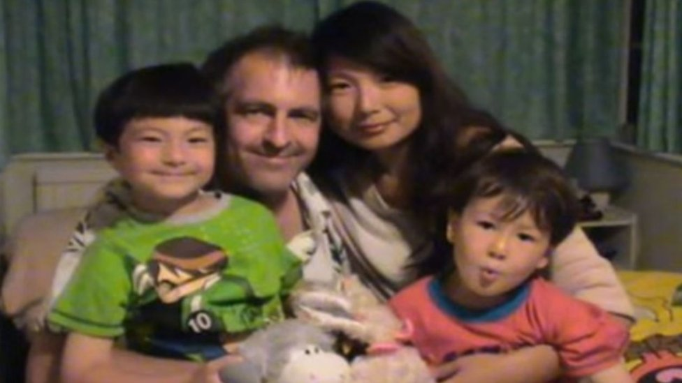 Andy Russell with his two sons and his wife Molly before she left for China