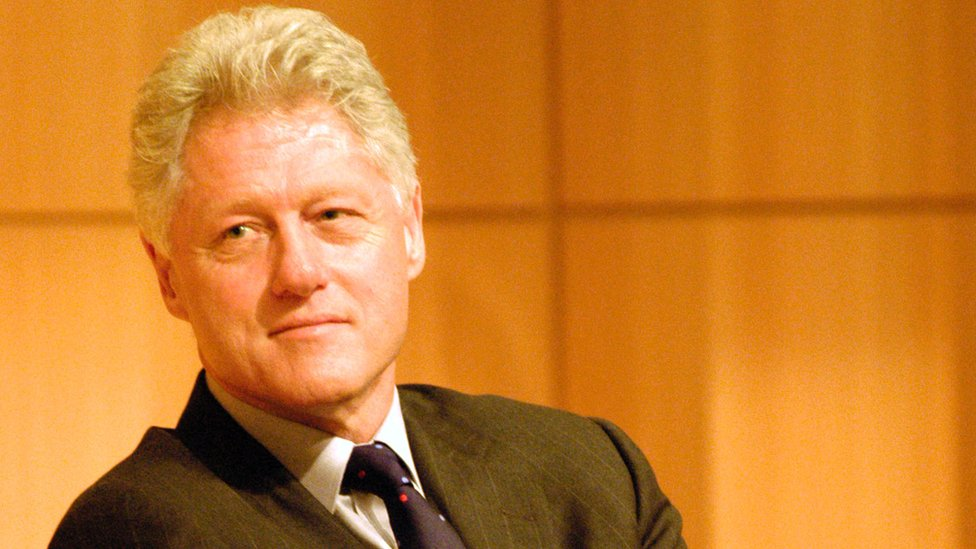 Bill Clinton listens to a speech by Czech President Vaclav Havel at the CUNY Graduate Center, 20 September 2002
