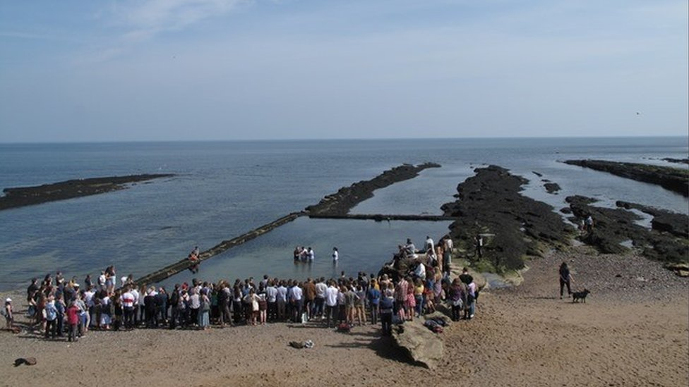 Margaret Squires sent in this photo of an Easter baptism in St Andrews