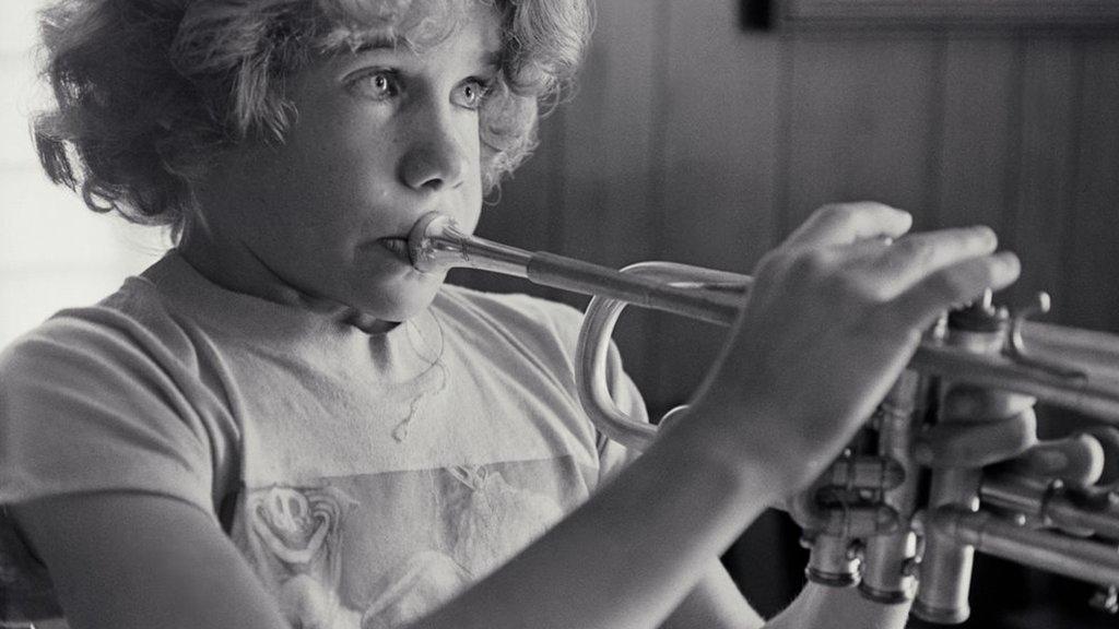 Flea plays the trumpet