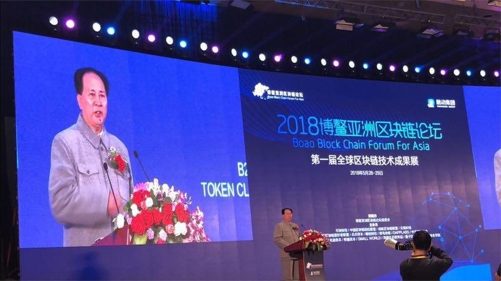 Mr Xu appears at a technology conference dressed as Chairman Mao at the Boao Blockchain Forum in Hainan Province China, 28 May 2018