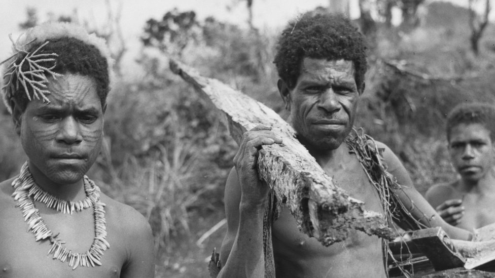 Father and son in Papua New Guinea's eastern highlands