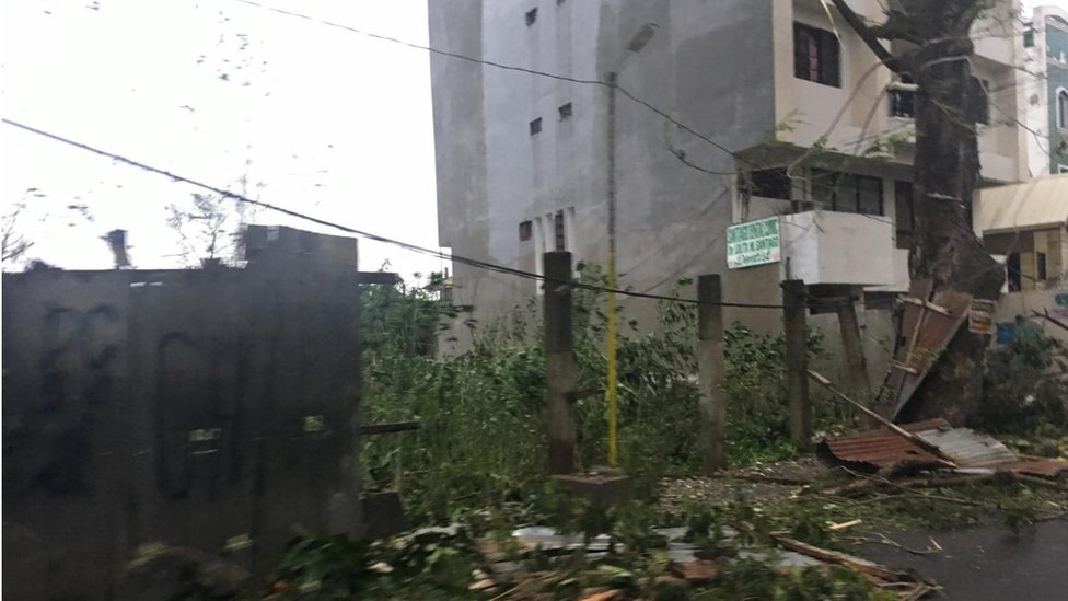 Storm damage and collapsed fencing in Tuguegarao