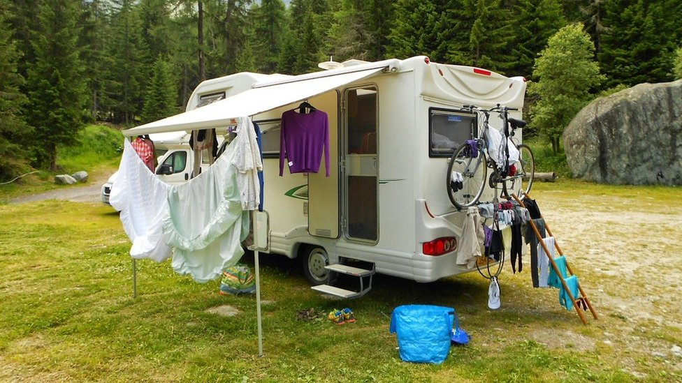 Washing hanging up outside campervan in forest