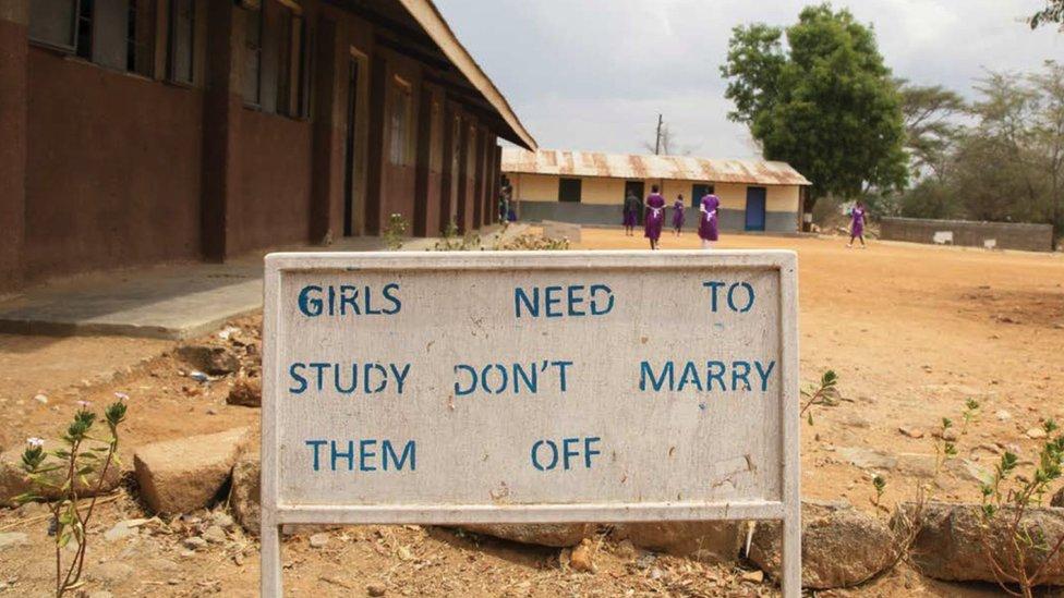 A school playground in Africa - a billboard reads
