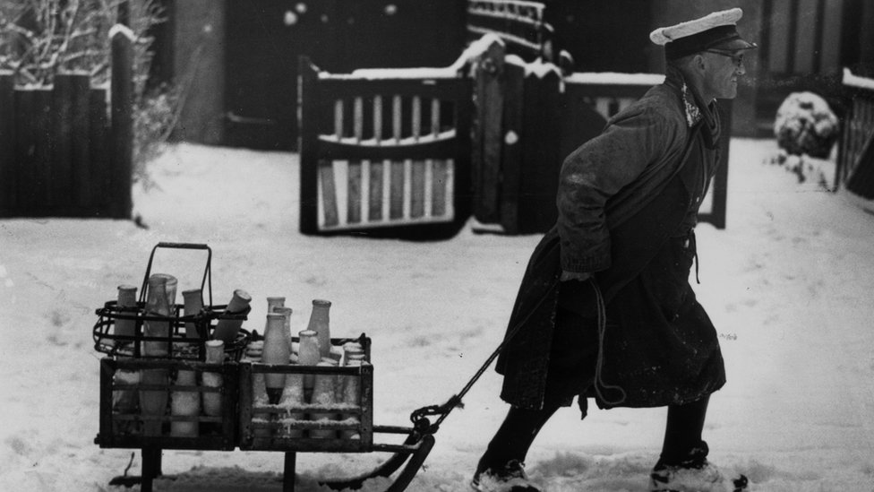 1947: A milkman in Cheam, Surrey, pulling his deliveries through the snow on a sledge