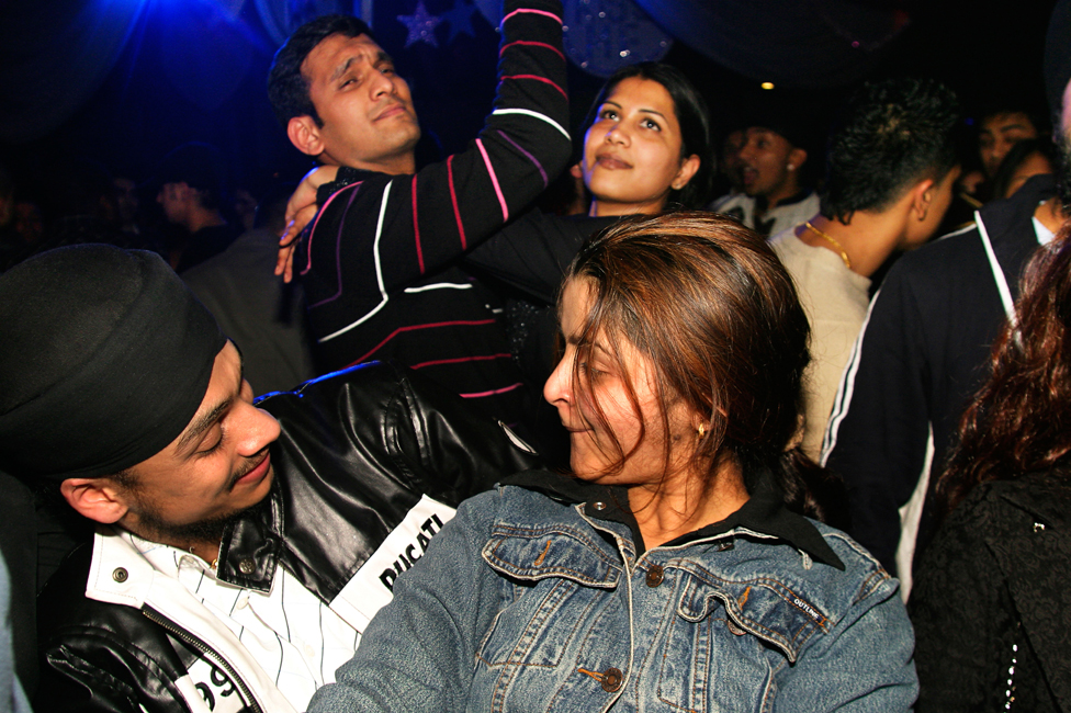 Young British Asians dancing
