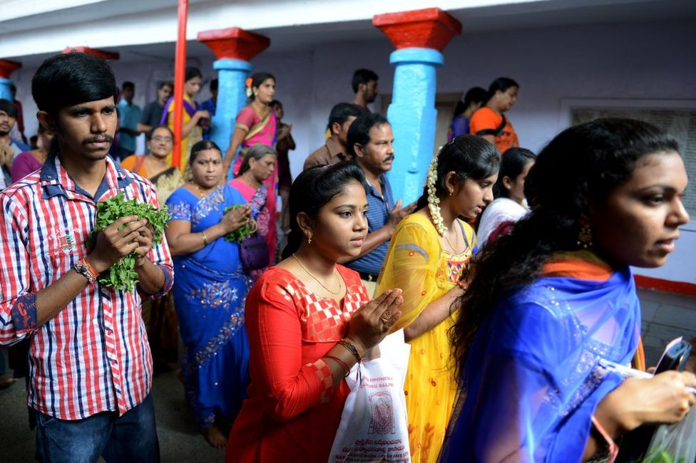 Indian students and others offer prayers to Lord Balaji, known as the 'Visa God', at a temple in Hyderabad city in 2017.