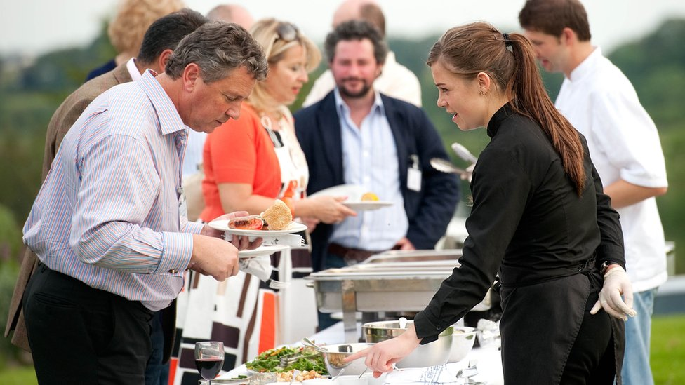Regis Banqueting staff catering an outdoor event