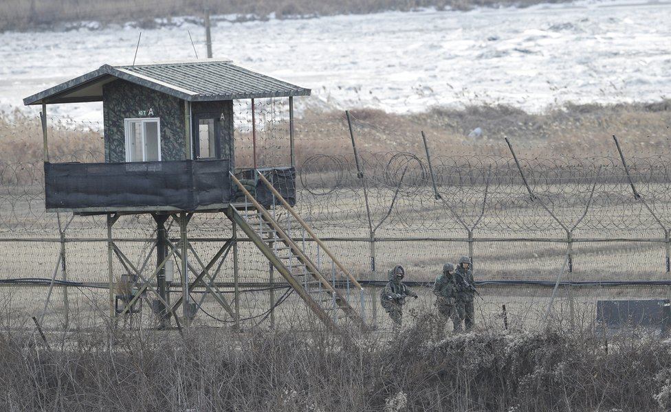In this 23 Jan 2016, photo, South Korean army soldiers patrol along the barbed-wire fence in Paju, near the border with North Korea, South Korea. North Korea has declared plans to launch an earth observation satellite later this month, an official with the London-based agency International Maritime Organization, said late Tuesday, Feb. 2, 2016.