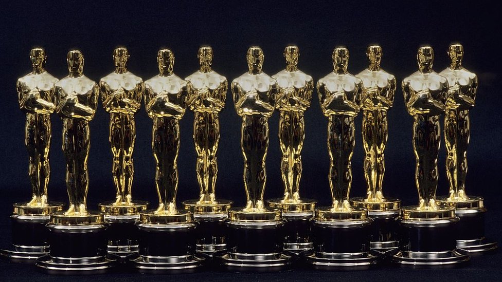 A view of 11 Oscars statues lined up next to each other in 1990 in Los Angeles, California.