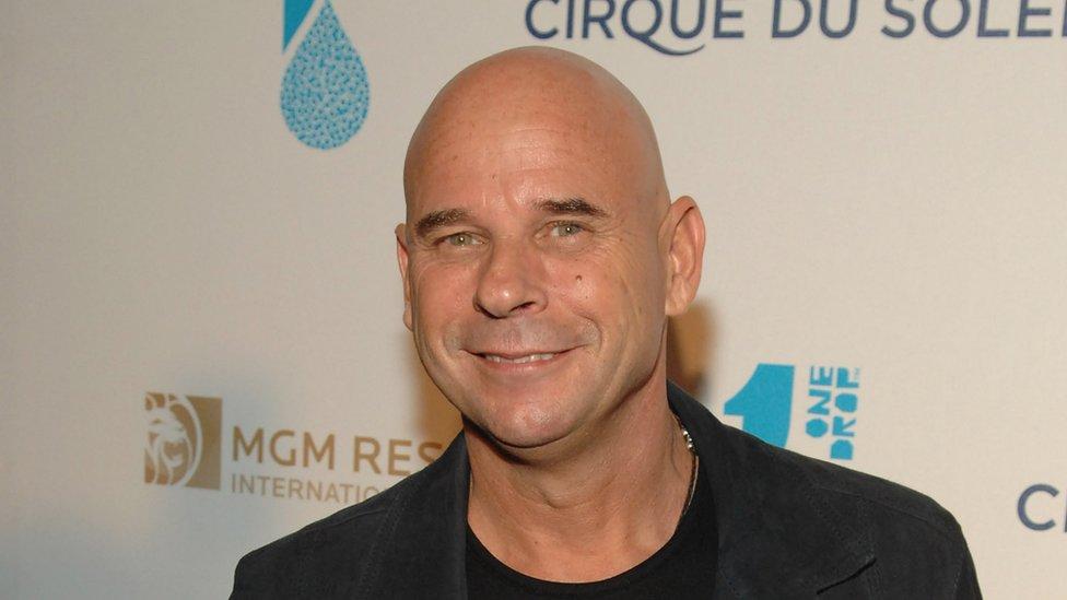 Guy Laliberté smiles at a Cirque du Soleil event