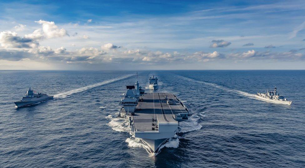 A view of frigate HNoMS Thor Heyerdahl, HMS Queen Elizabeth, submarine hunter HMS Northumberland and tanker RFA Tideforce