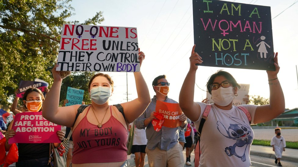 Supporters of reproductive choice take part in the nationwide Women's March in Brownsville, Texas, on 2 October, 2021
