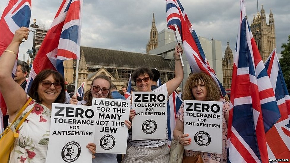 Members of the Campaign against anti-Semitism demonstrate outside Parliament