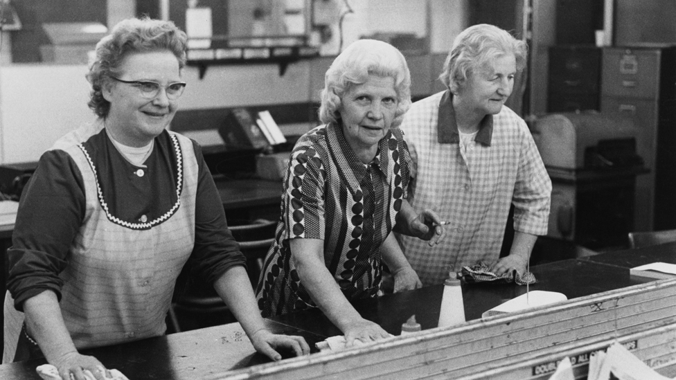 Three office cleaners at work after hours, October 1973. They are Mrs Mabel Warren, Mrs Betty Stone and Mrs Flo Ring