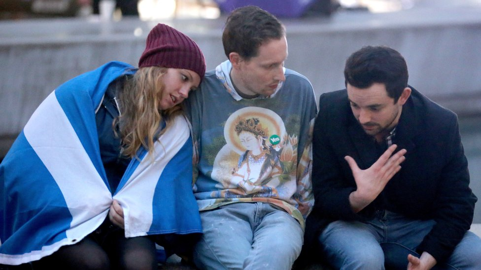 Yes vote campaigners console themselves outside the Scottish Parliament building after the people of Scotland voted no to independence on September 19, 2014 in Edinburgh, Scotland