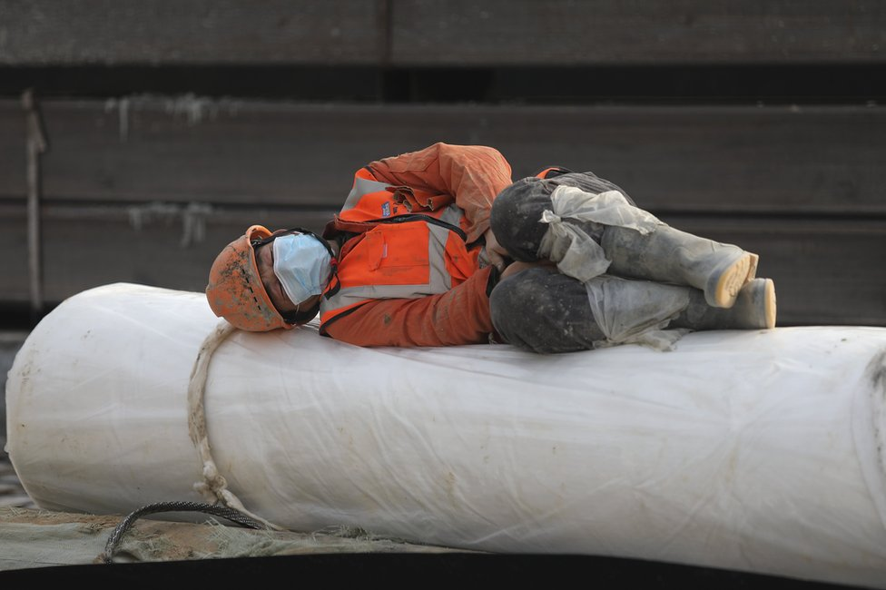 A construction worker rests