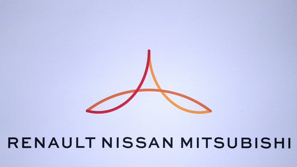 Renault-Nissan-Mitsubishi logo is displayed during a 2017 press conference