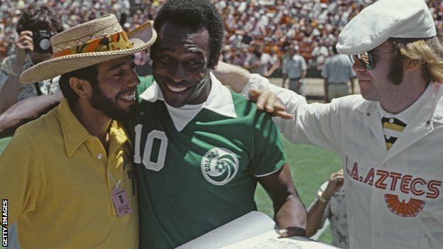 Pele, pictured with Brazilian musician Sergio Mendes and Elton John
