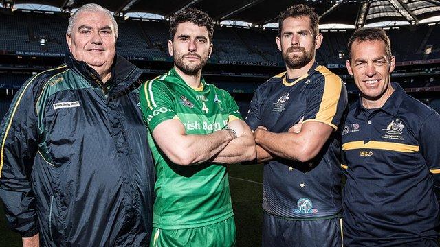 Ireland manager Joe Kernan and captain Bernard Brogan with Australia skipper Luke Hodge and head coach Alastair Clarkson