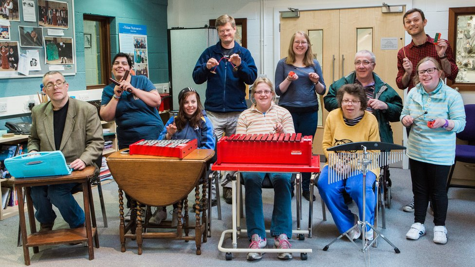 Members of a music group for people with learning disabilities with instruments provided by the trust