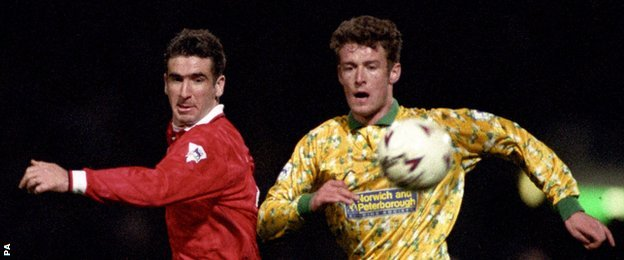 Man Utd's Eric Cantona and Norwich's Chris Sutton challenge for the ball in April 1993