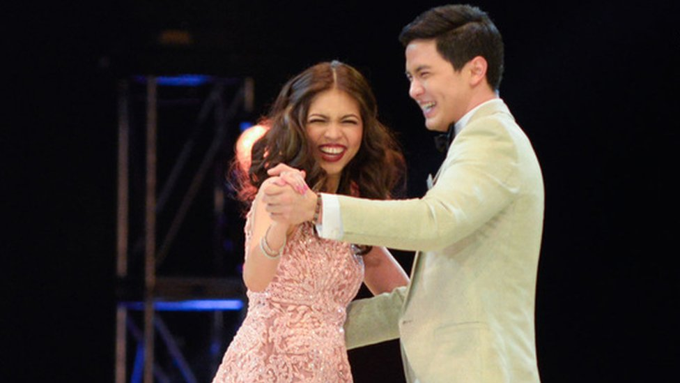 Filipino actors Alden Richards and Maine Mendoza perform at a charity concert in Manila, the Philippines