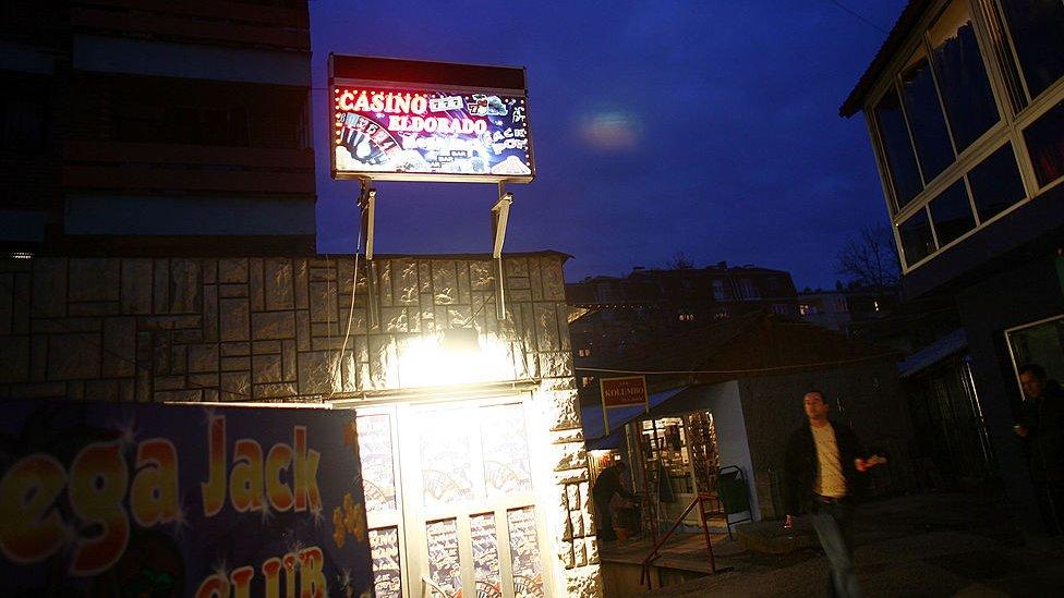 A sign for a casino is illuminated in Mitrovica, Kosovo, in 2007