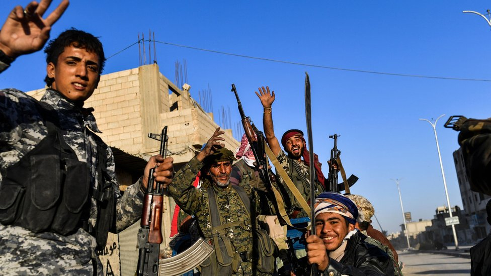 Members of the Syrian Democratic Forces (SDF), celebrating their victory over IS militants