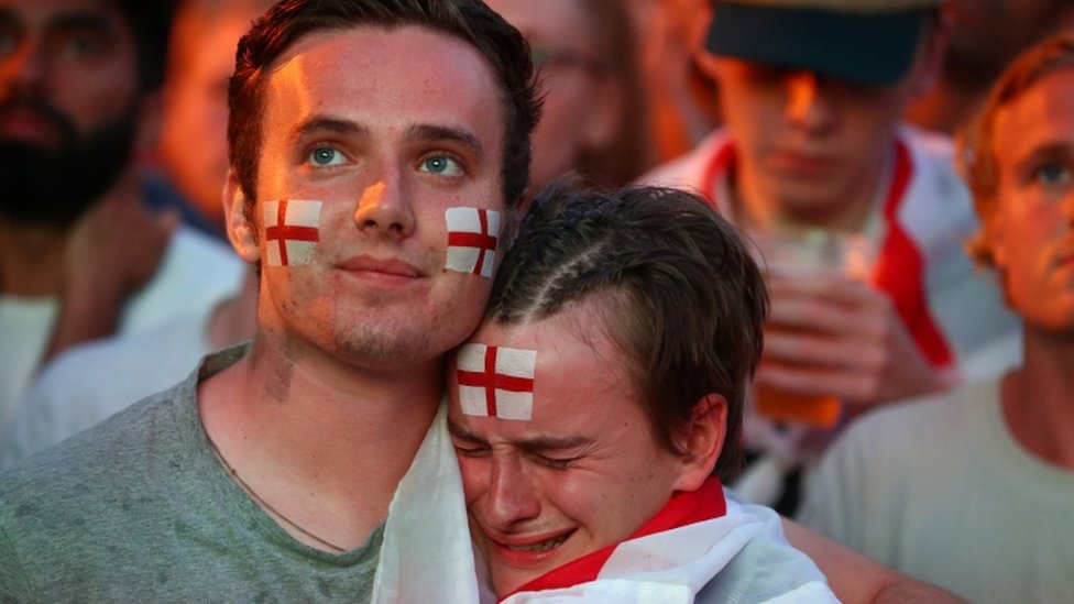 Devastated fans on Brighton Beach