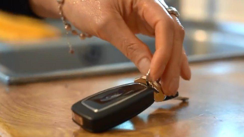 Close up hand with car keys