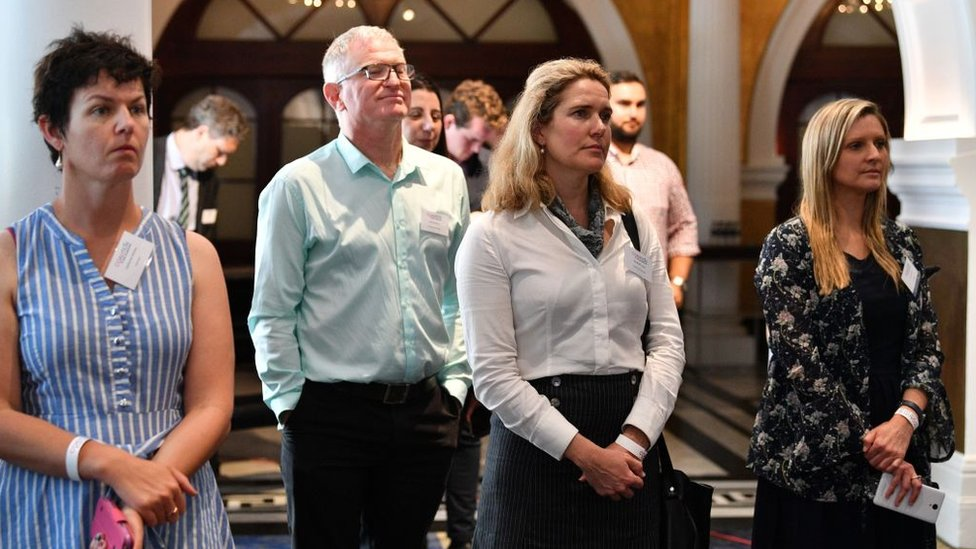 People listen to No campaigner Lyle Shelton speak after the result