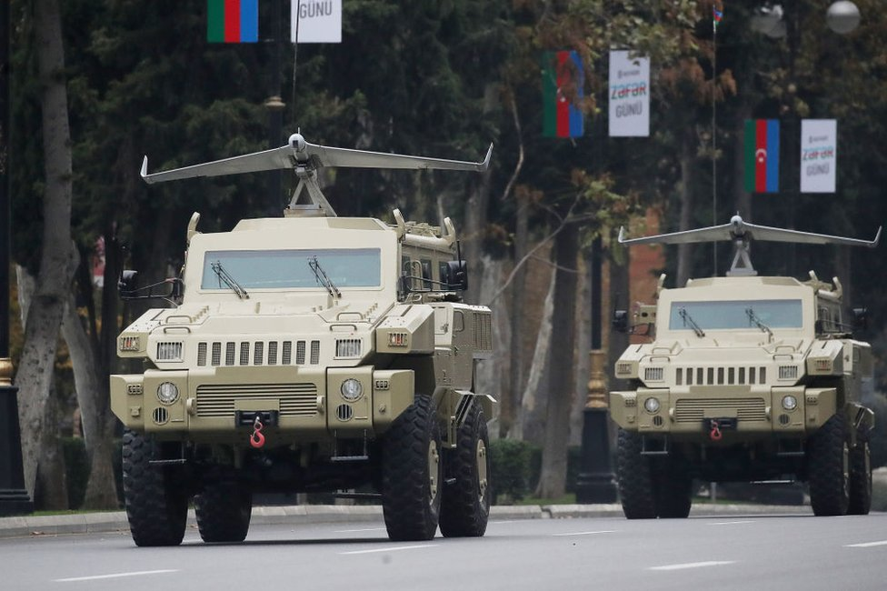 Military vehicles carrying drones made by an Azeri-Israeli joint venture take part in a rehearsal for a military parade in the capital, Baku