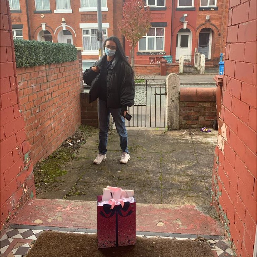 Lily, in isolation, collecting a birthday present