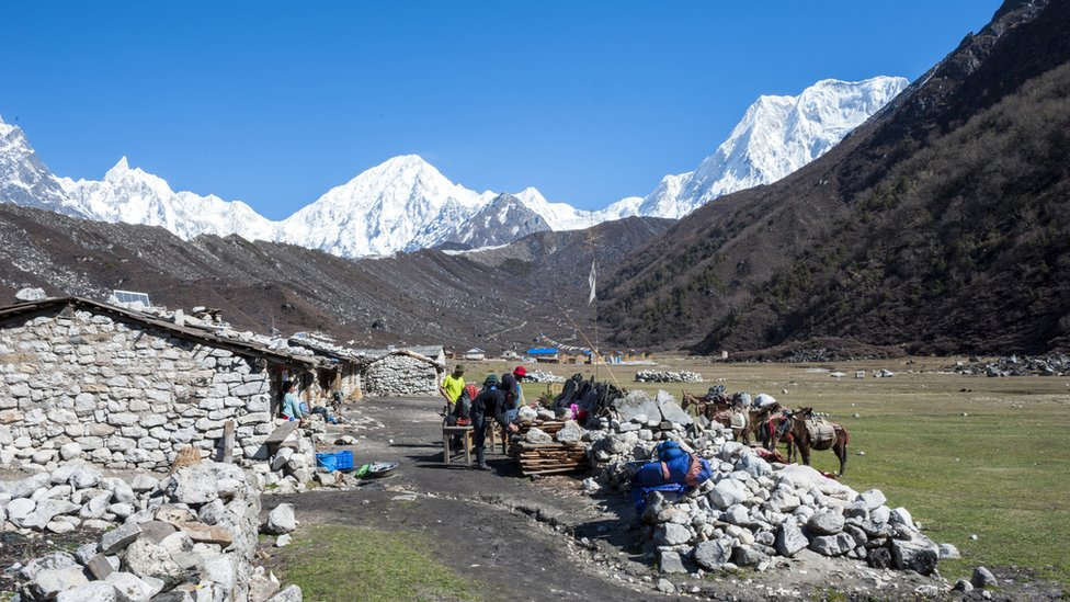Trekkers in the village of Bimthang as part of the Great Himalaya Trail