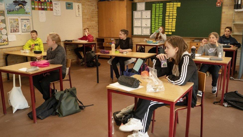 Children back in school in Denmark, sitting far apart