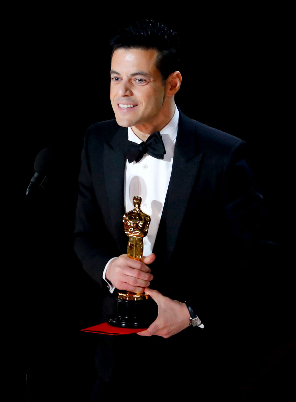 Rami Malek accepts the Best Actor award