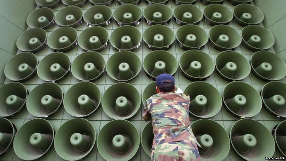 JUNE 16: A South Korean soldier takes down a battery of propaganda loudspeakers on the border with North Korea in Paju on 16 June 2004 in Paju, South Korea.