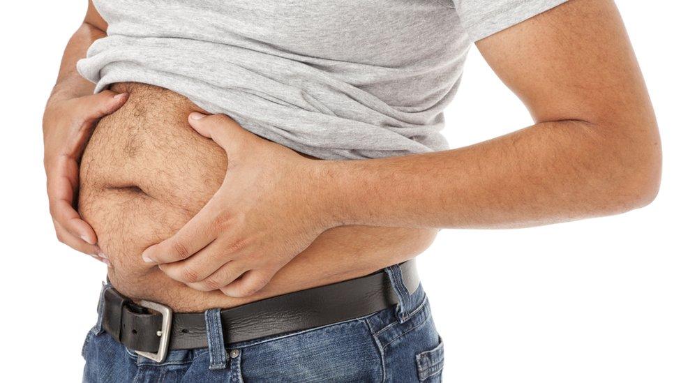 Persona con grasa abdominal