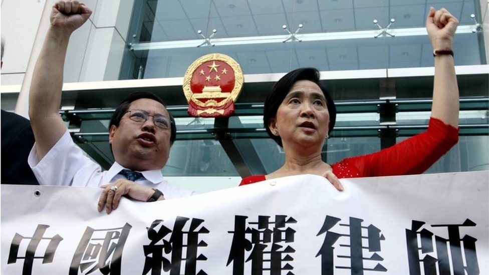 A group from the China Human Rights Lawyers Concern Group including legislators Albert Ho and Emily Lau hold a protest at the China Liaison Office in Hong Kong, 22 June 2007.