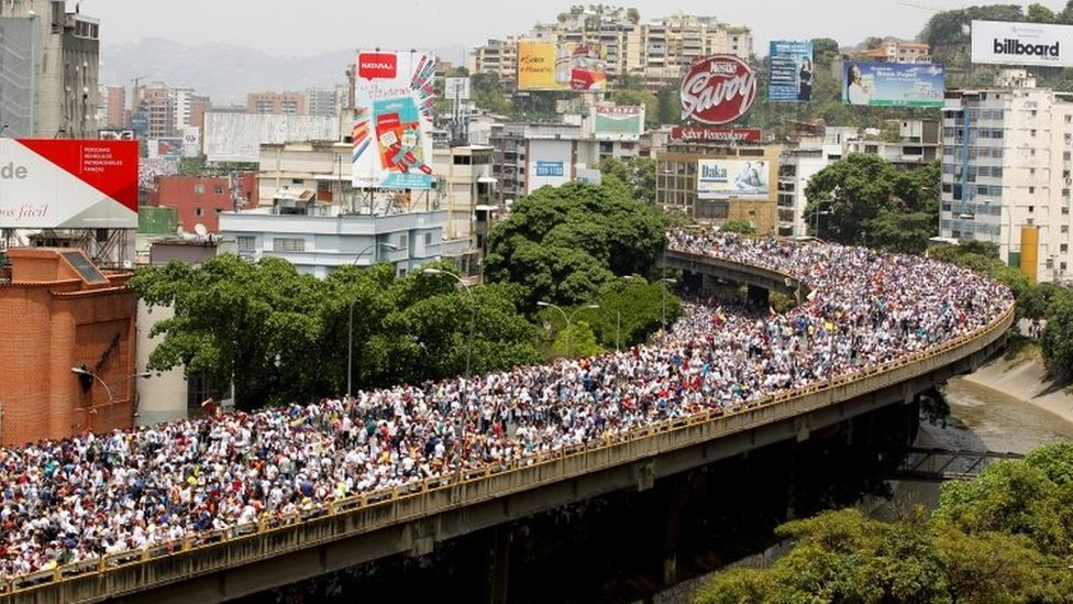 """Demonstrators rally during the so-called """"mother of all marches"""" against Venezuela's President Nicolas Maduro in Caracas, Venezuela April 19, 2017"""