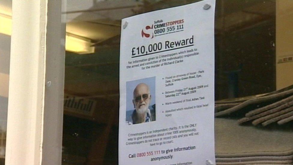 A reward poster in a shop window